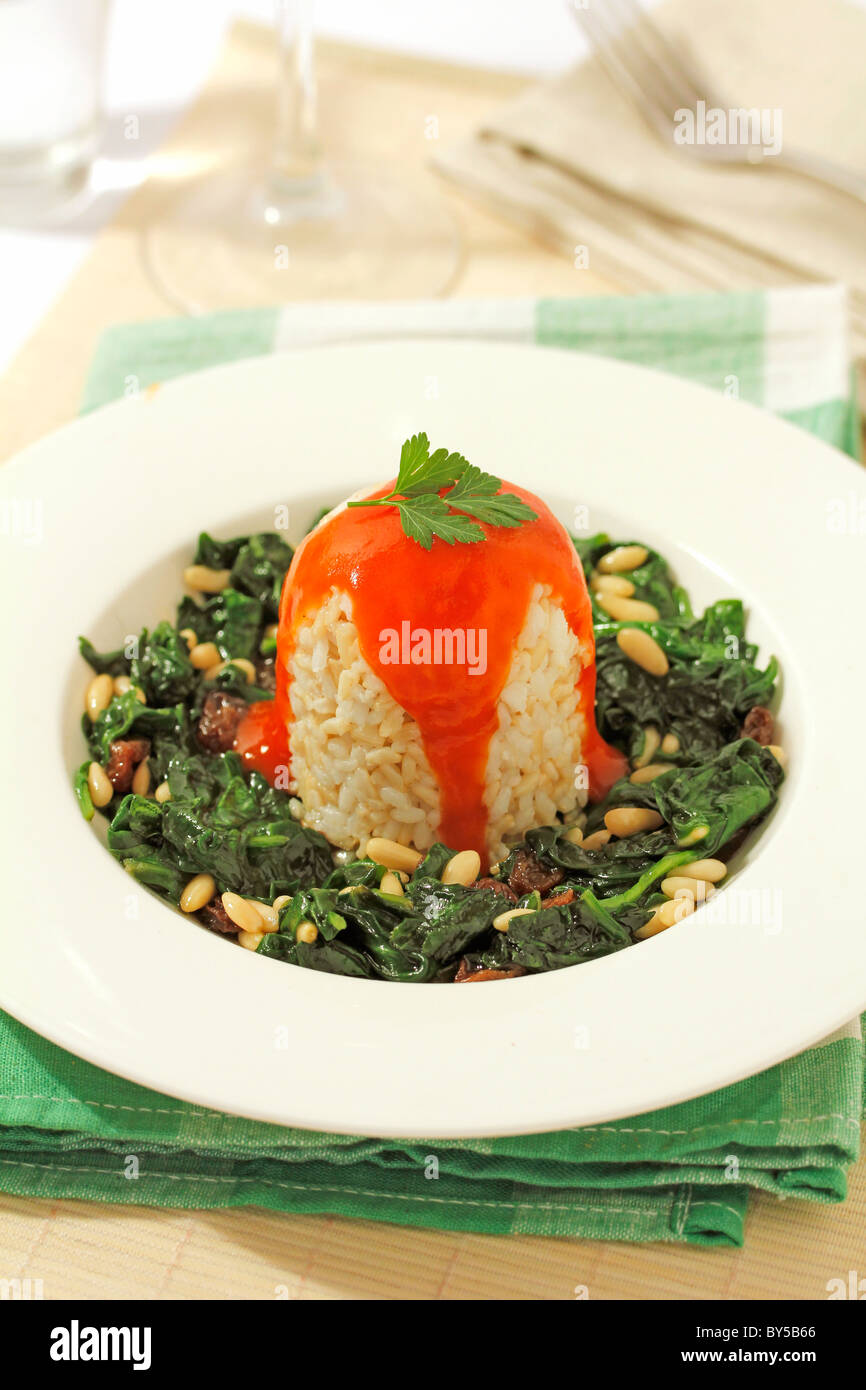 Wholemeal rice with spinach. Recipe available. - Stock Image