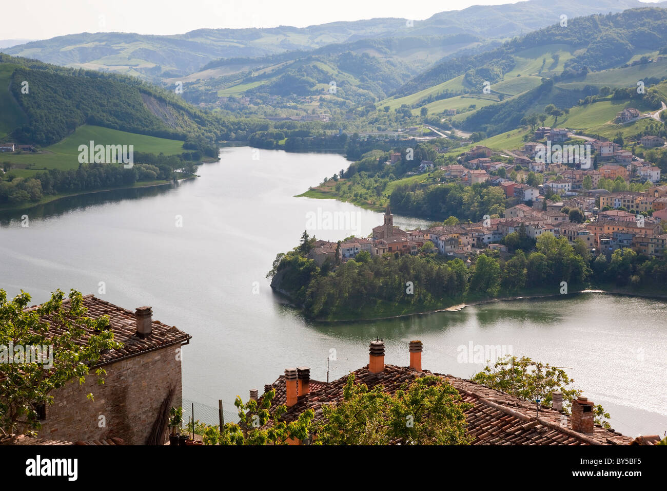 View over lake from Sassocorvaro village to Mercatale village, Marche, Italy - Stock Image