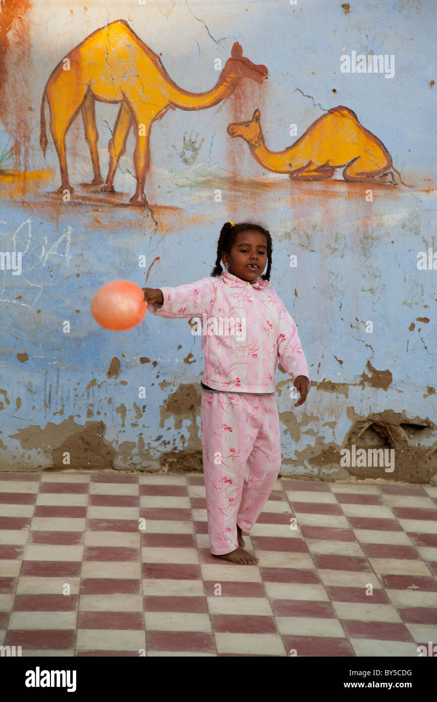 Young children at play in Nubian village outside Aswan, Egypt 2 - Stock Image