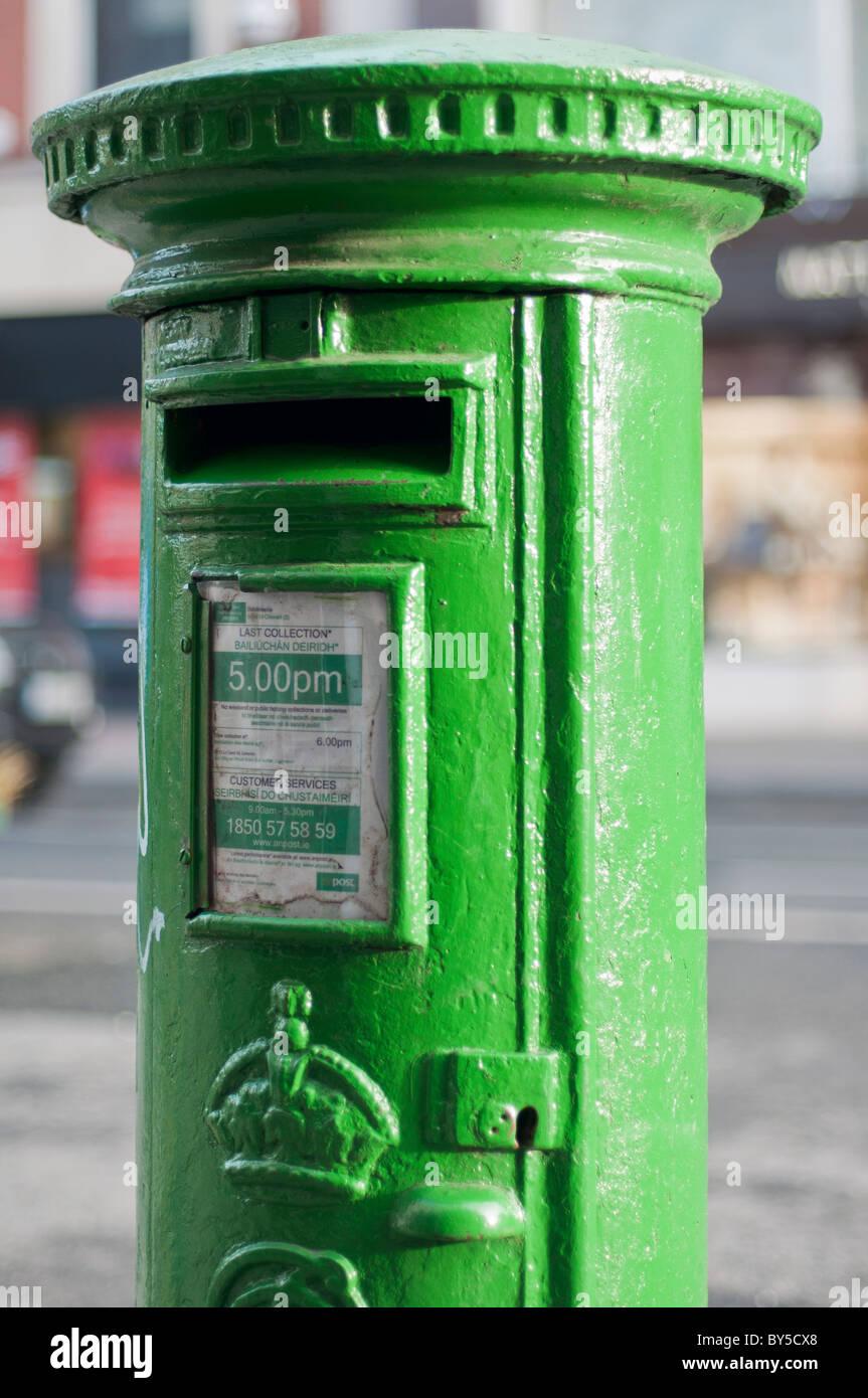 A green Irish postbox in Limerick, Republic of Ireland - Stock Image