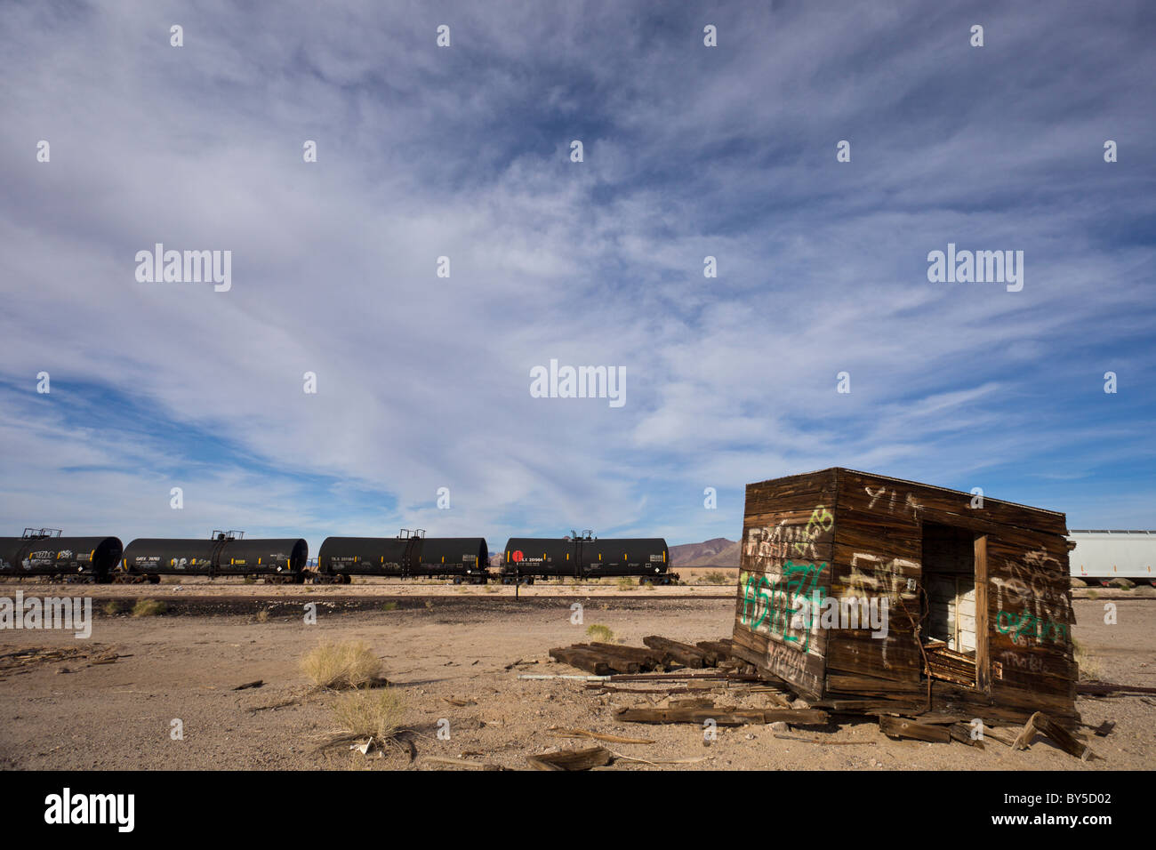 Abandoned depot with train and tracks along Highway 62 in the ghost town of Rice, California, USA. Stock Photo
