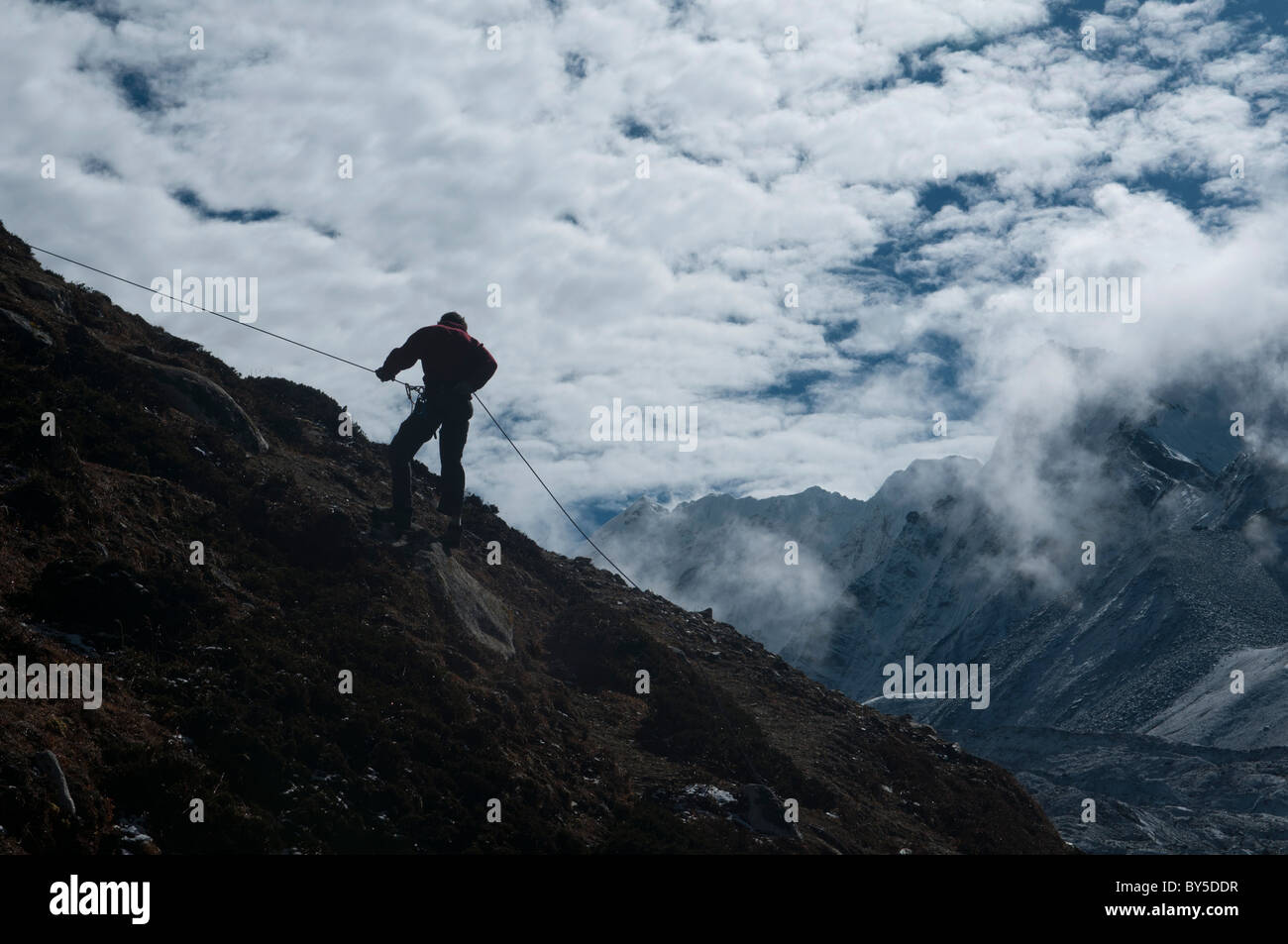 climber abseiling in the Everest Region of Nepal - Stock Image