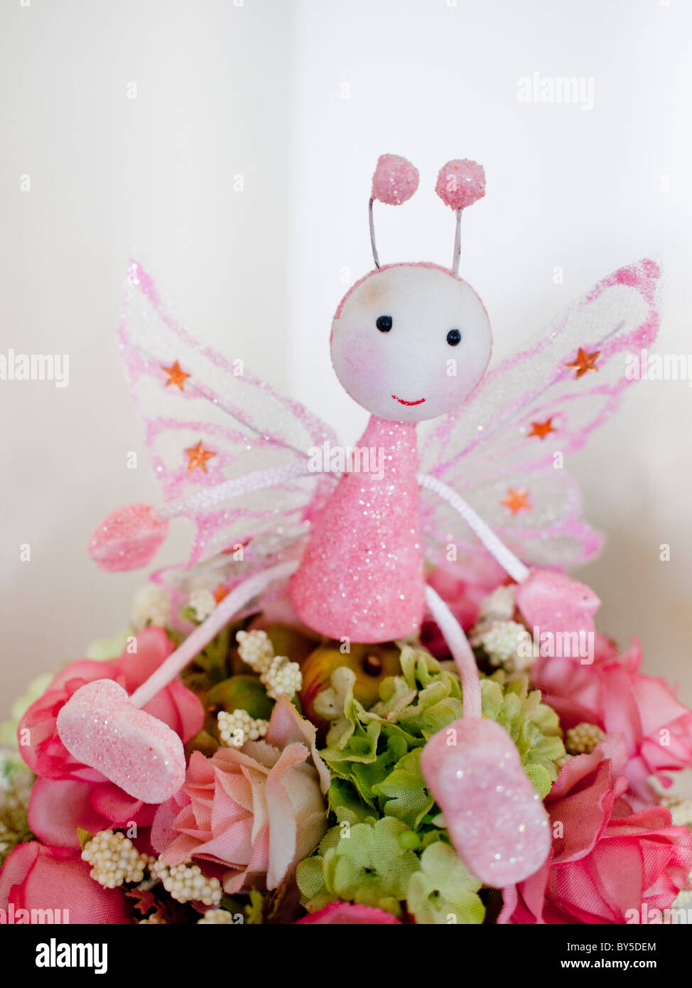 Fairy wings pink flower stock photos fairy wings pink flower stock a flower fairy angle in pink with wide wings stock image mightylinksfo