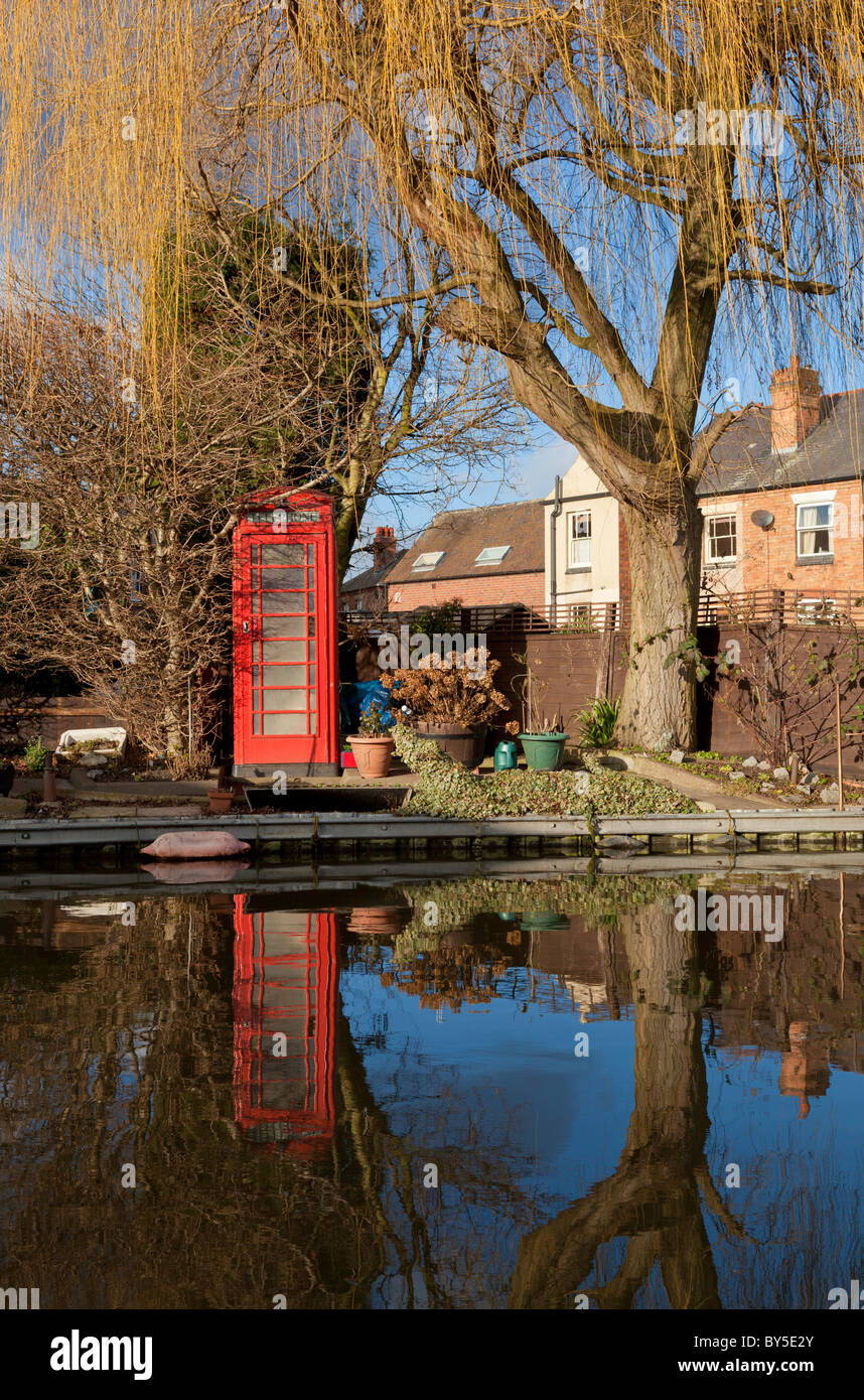 Red telephone box next to the 'trent and Mersey' canal Shardlow  Derbyshire England UK GB EU Europe - Stock Image