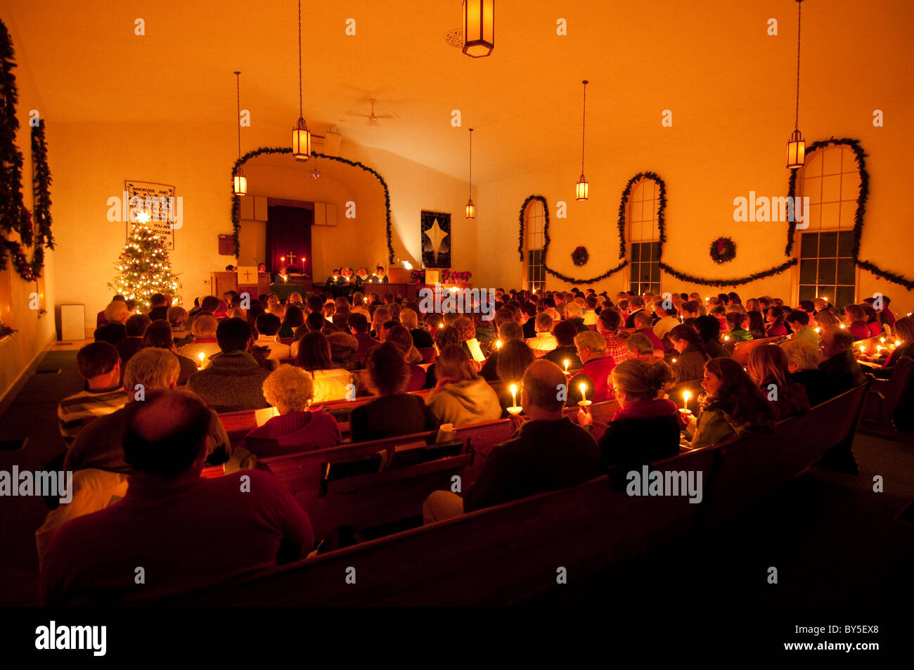 Christmas Eve Candlelight mass at church in Waitsfield Mad River Valley Vermont USA - Stock Image