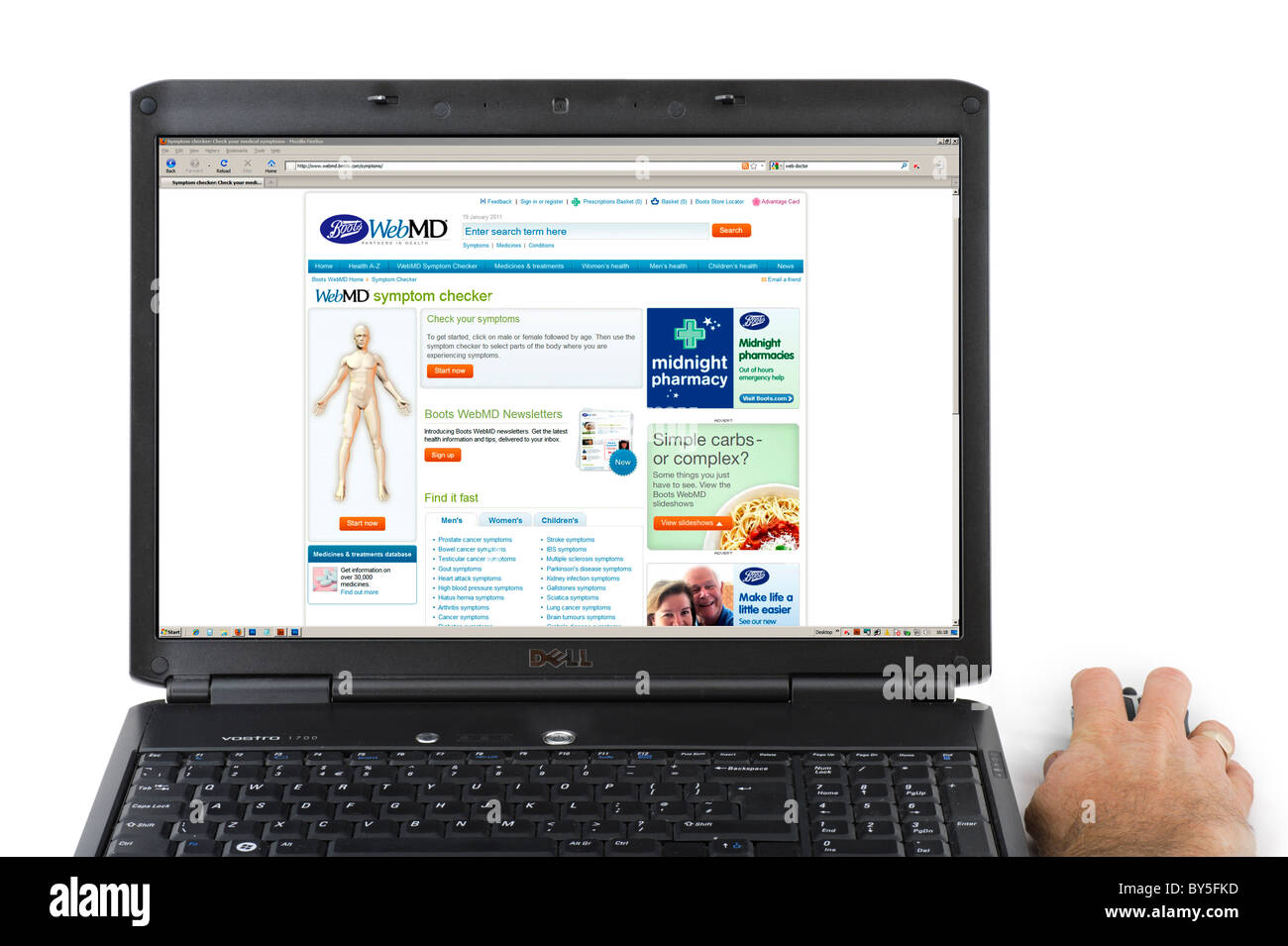 Looking at symptoms on the Boots WebMD website, UK - Stock Image