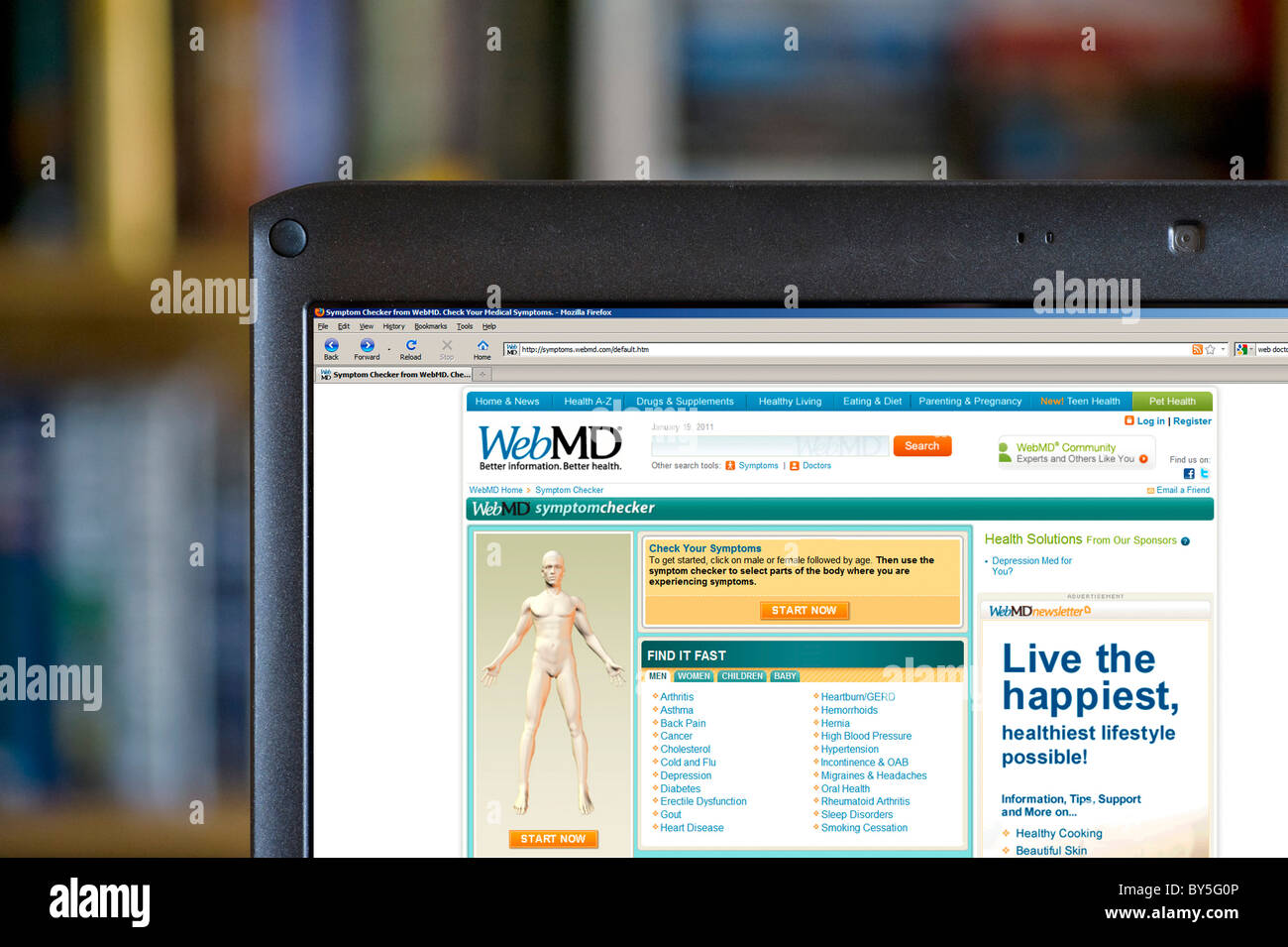 Looking at symptoms on the WebMD website, USA - Stock Image