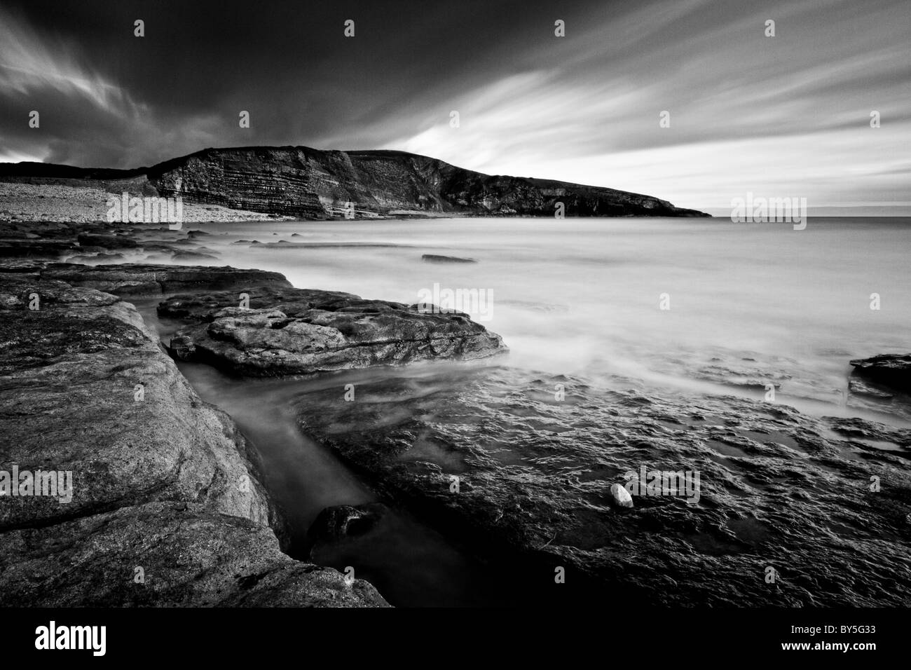 Long exposure of Dunraven Bay in black and white - Stock Image
