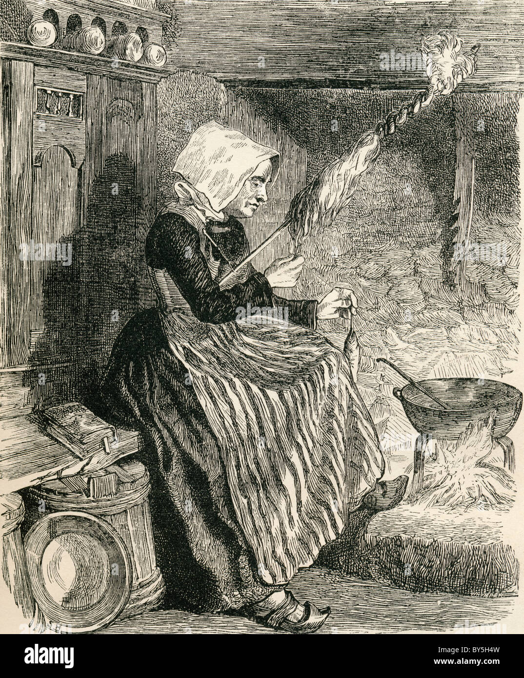 A Breton peasant woman spinning wool in the19th century. From French Pictures by The Rev. Samuel G. Green, published - Stock Image