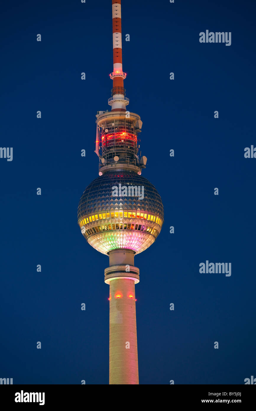 Germany, Bavaria, Berlin, the Berlin television broadcast tower at Alexander platz illuminated at night - Stock Image