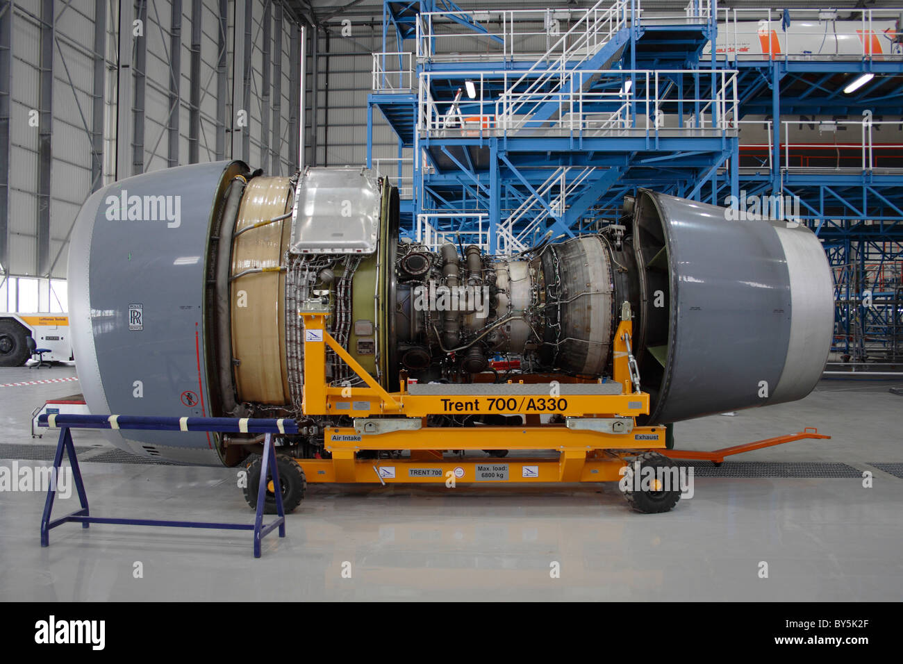 Rolls-Royce Trent 700 turbofan jet engine partially dismantled and undergoing maintenance - Stock Image