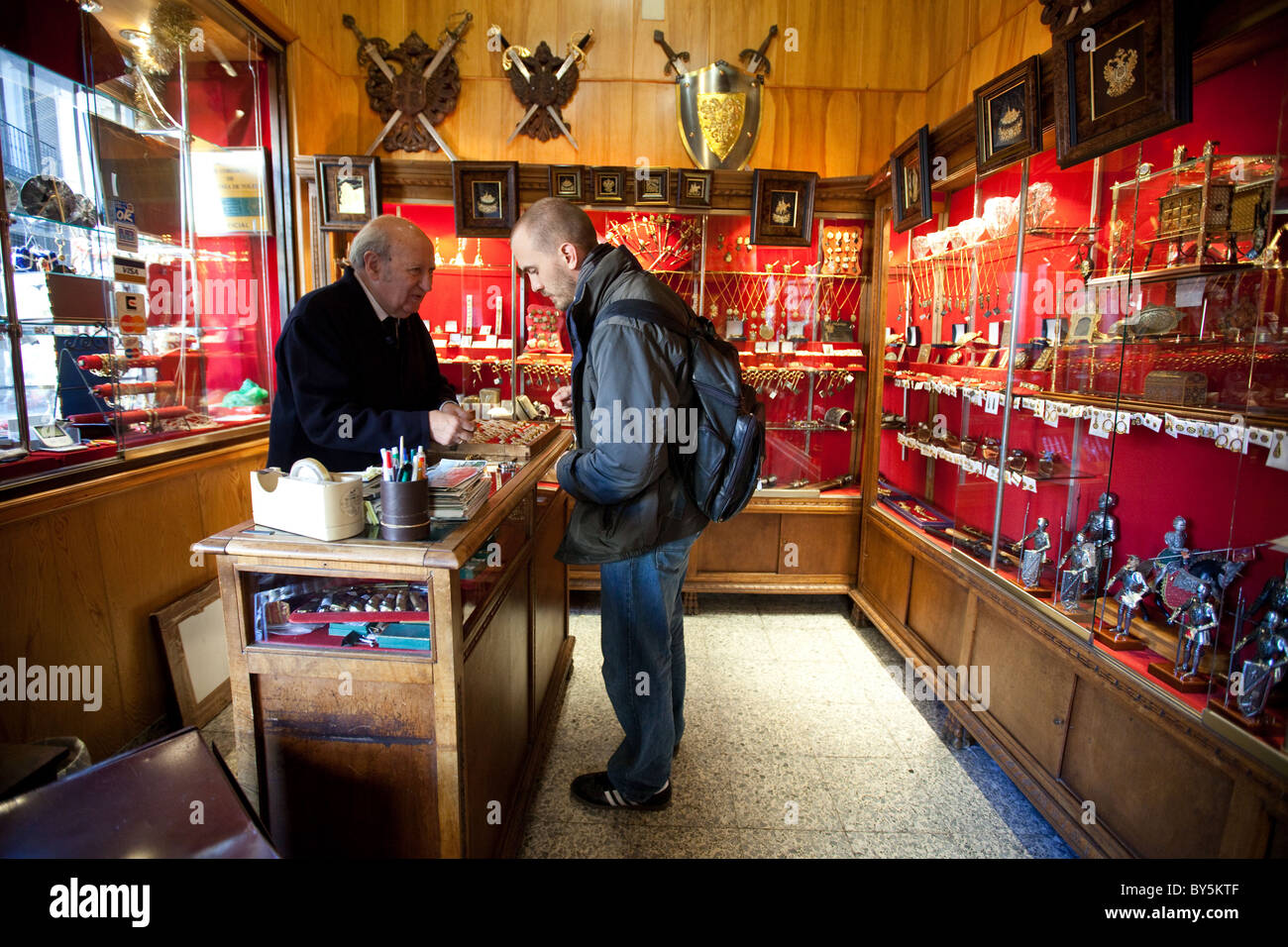 Man buying gold jewelry in a shop in Toledo Spain Stock Photo