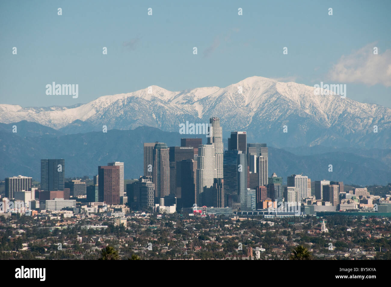 Downtown Los Angeles skyline and snow capped San Gabriel Mountains Southern California USA Stock Photo