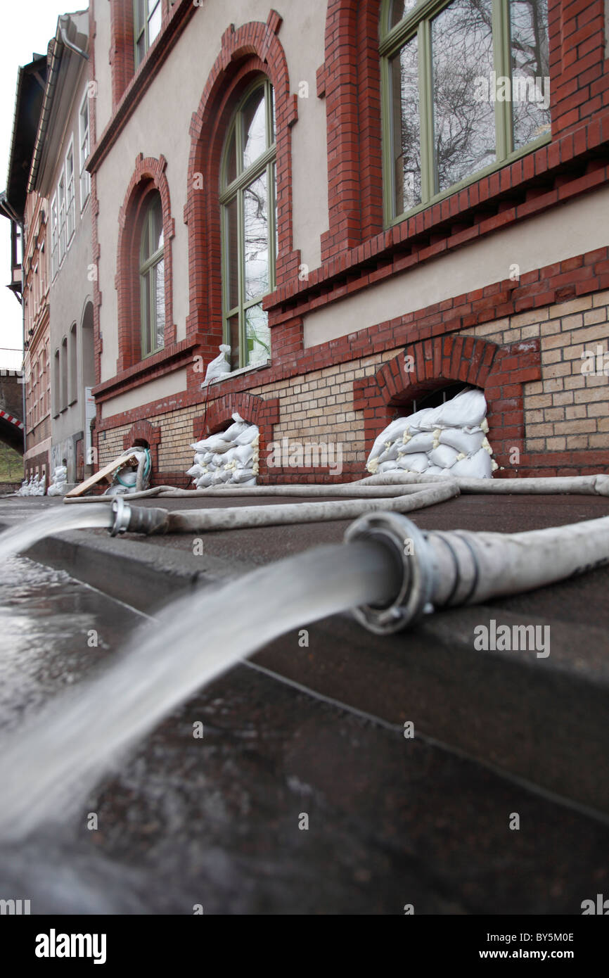 water pumping from cellars after flooding in Halle (Saale) in Germany - Stock Image
