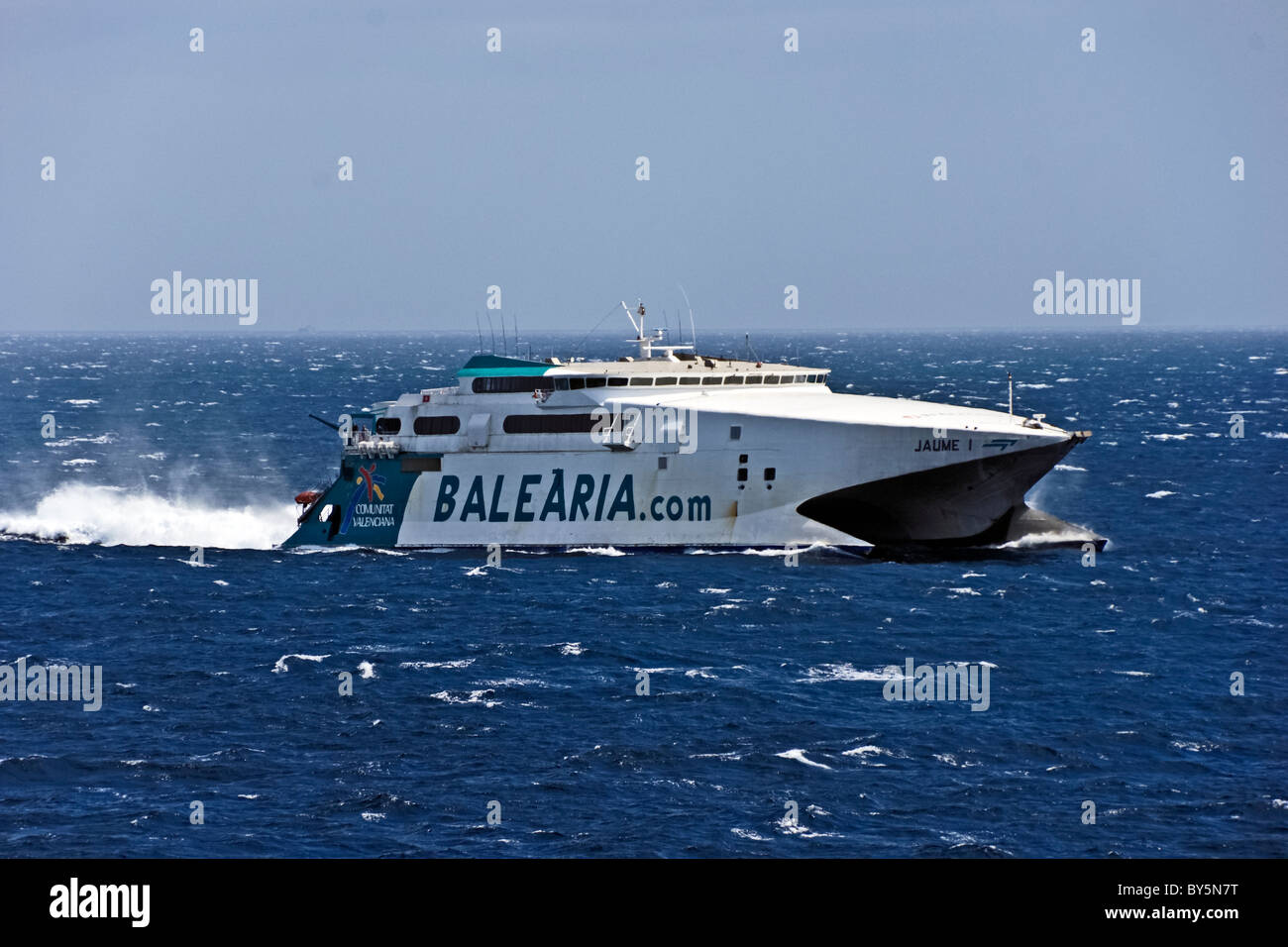Balearia InCat catamaran ferry Jaume 1 is seen here off Gibraltar between Algeciras and Tangier - Stock Image