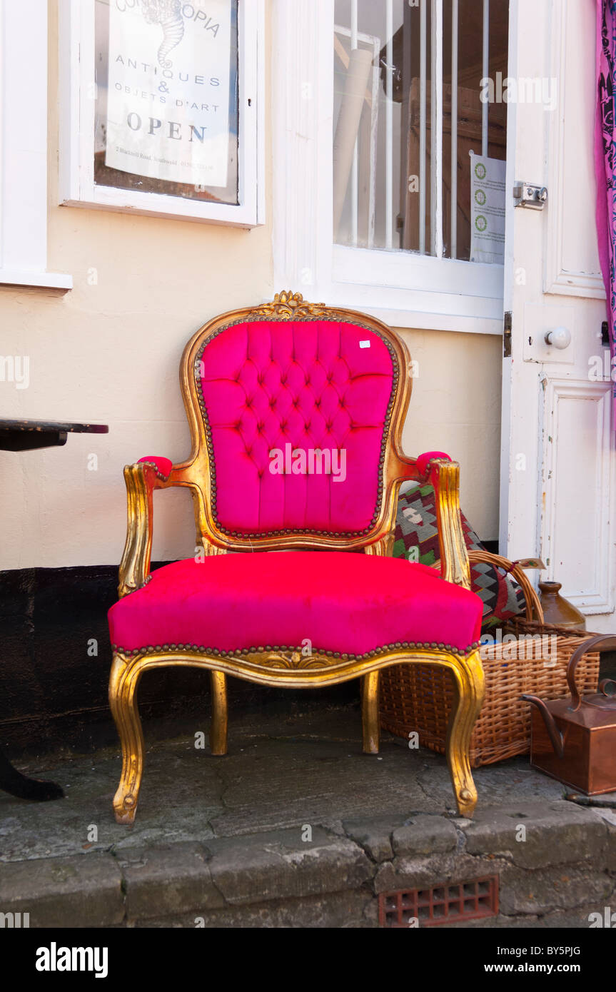 An unusual pink throne chair for sale outside an antique shop store in the  Uk - An Unusual Pink Throne Chair For Sale Outside An Antique Shop Store