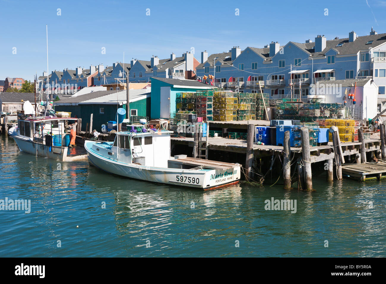 Commercial lobster fishing boats tied to pier in Portland