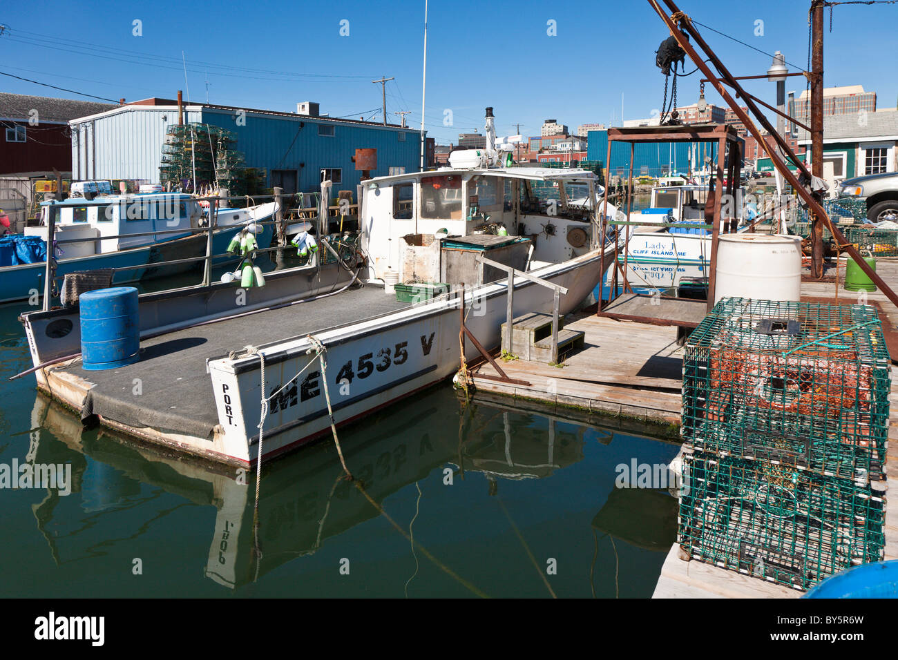 Commercial lobster boat at dock in Portland, Maine Stock