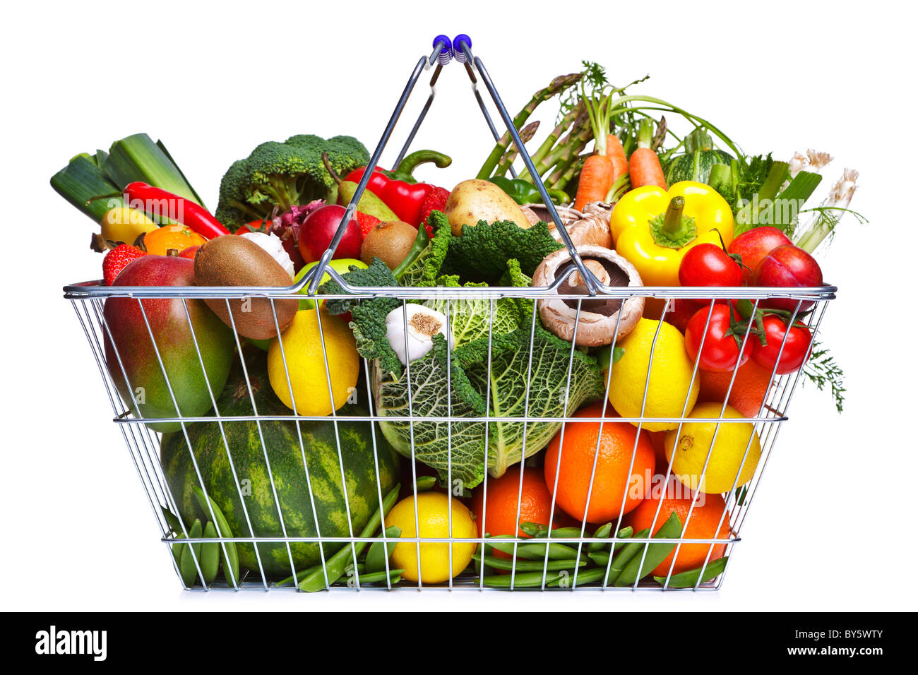 Photo of a wire shopping basket full of fresh fruit and vegetables, isolated on a white background. - Stock Image