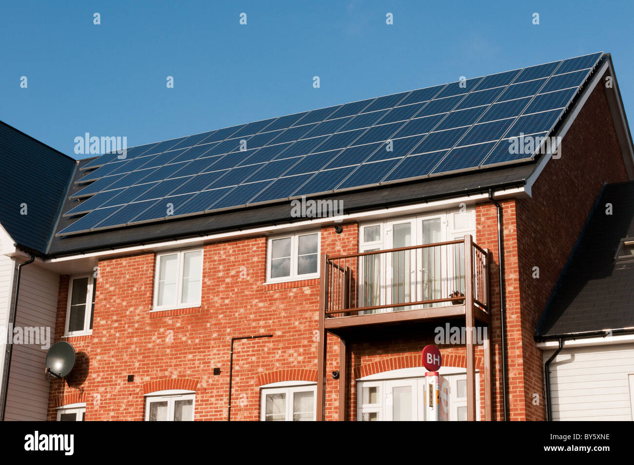 A renewable energy supply in the form of photovoltaic panels on the roof of a new development in Bromley, Kent, - Stock Image