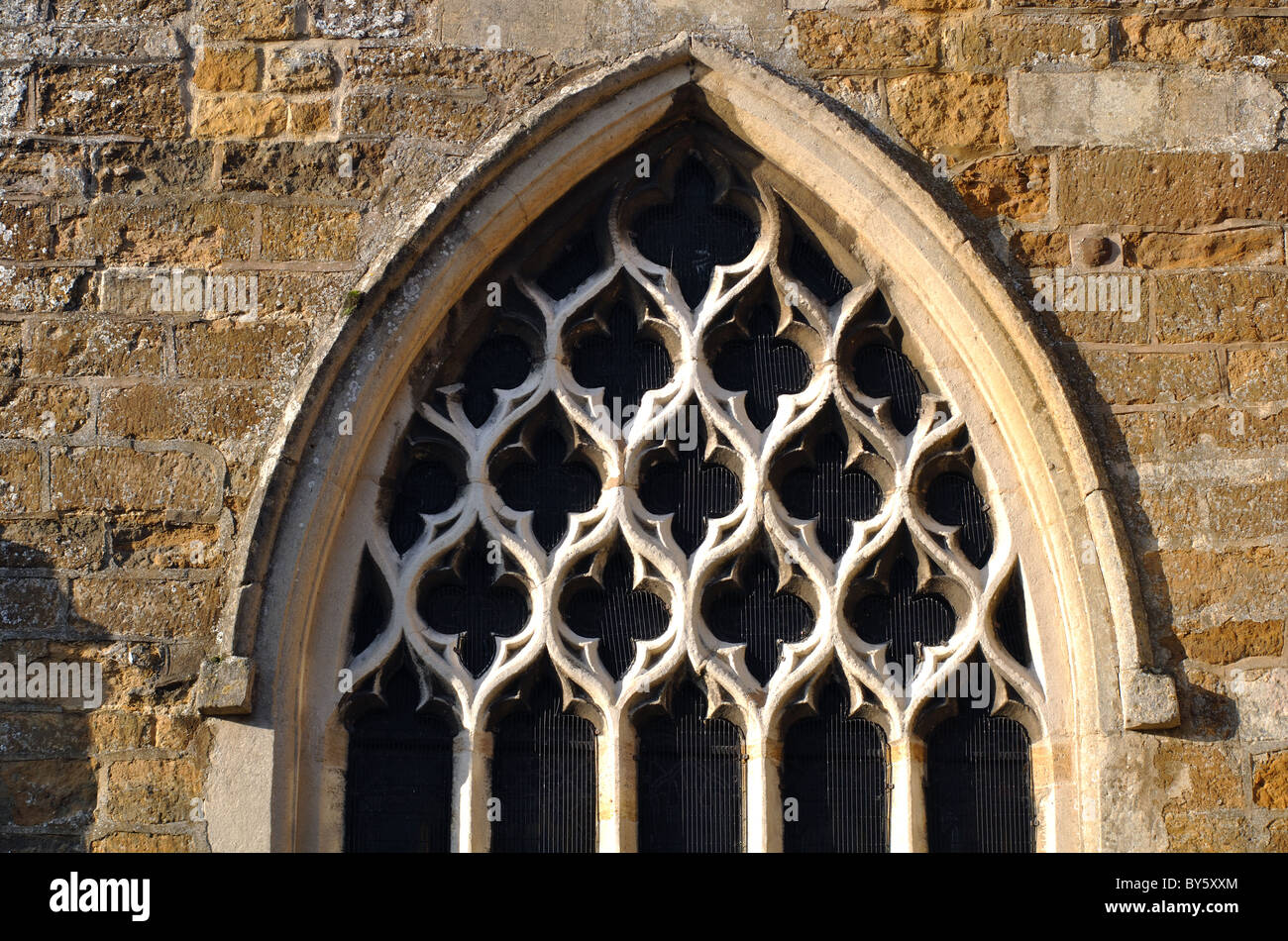 Window tracery, St. Wilfrid`s Church, Kibworth, Leicestershire, England, UK - Stock Image