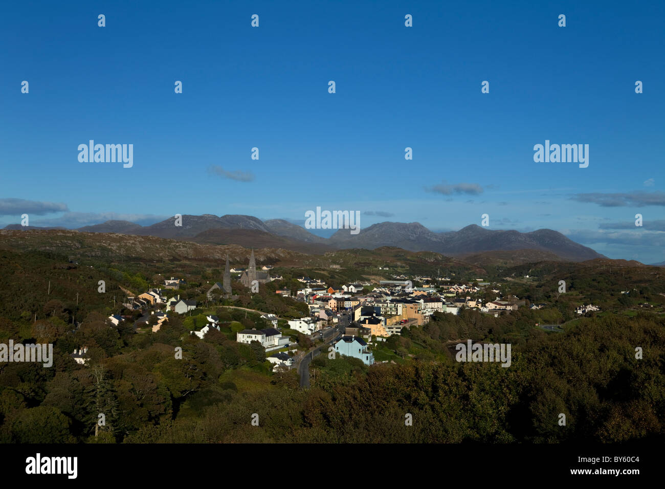 Clifden Town with the Distant 12 Pins Mountains, Connemara, County Galway, Ireland - Stock Image