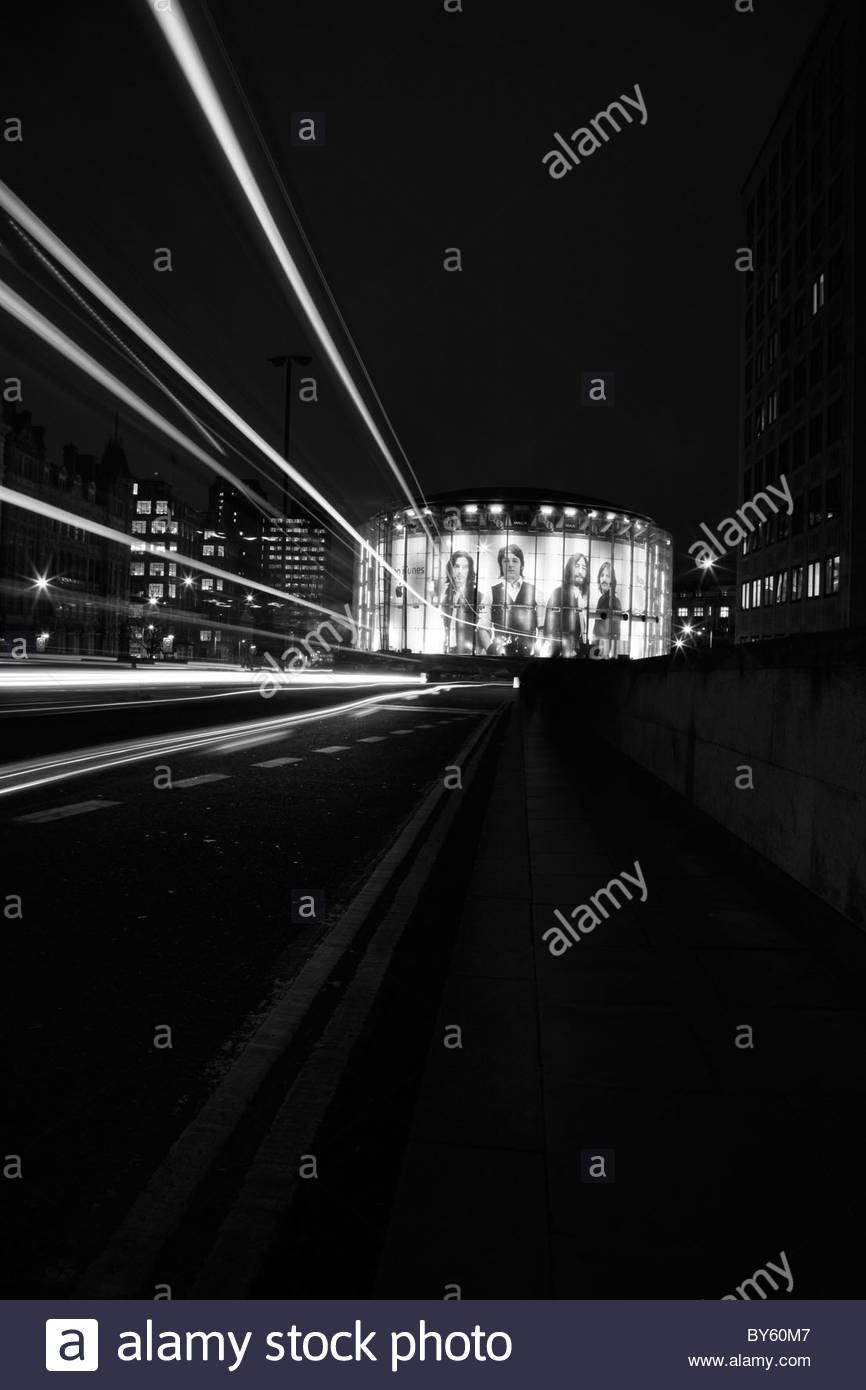 View of the iTunes Beatles billboard on the IMAX cinema taken from Waterloo Bridge, South Bank, London, UK - Stock Image