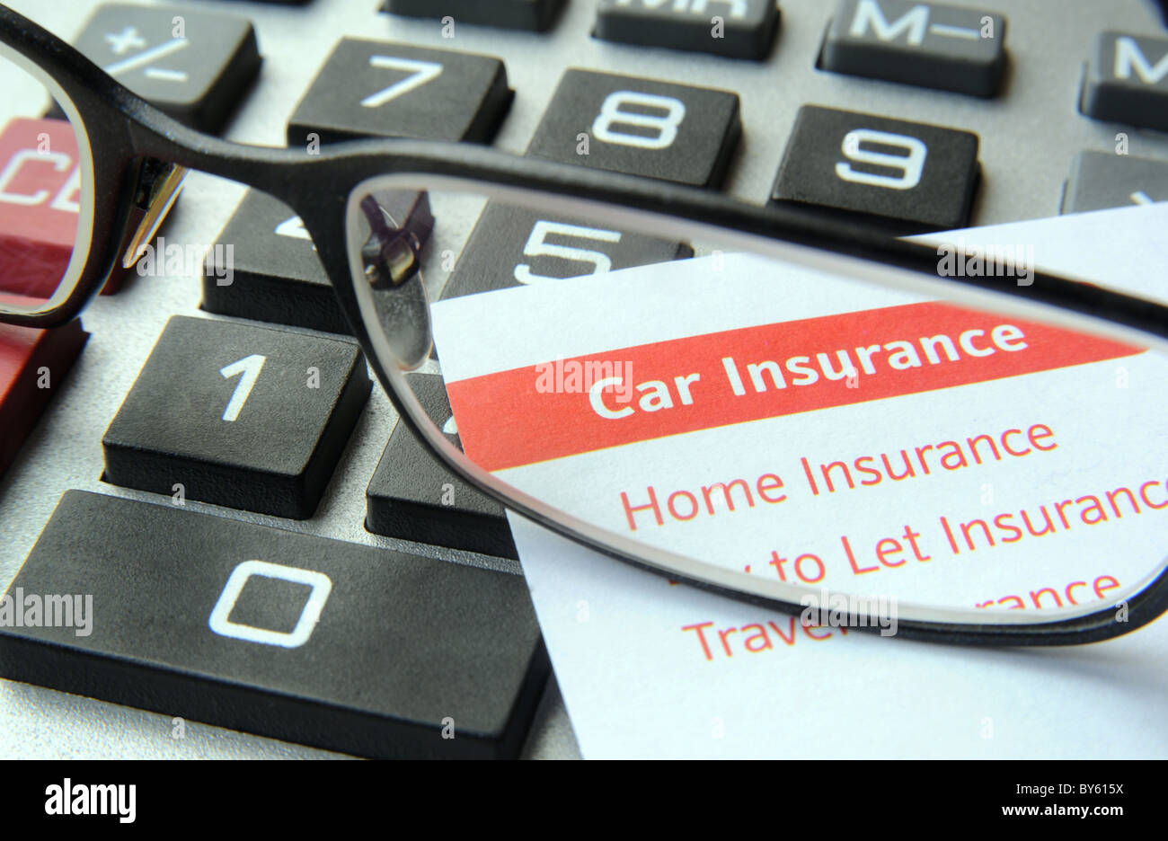 CAR AND HOME INSURANCE LETTER WITH CALCULATOR RE HOME AND CAR INSURANCE COSTS PREMIUMS RENEWAL HOUSEHOLD BUDGET - Stock Image