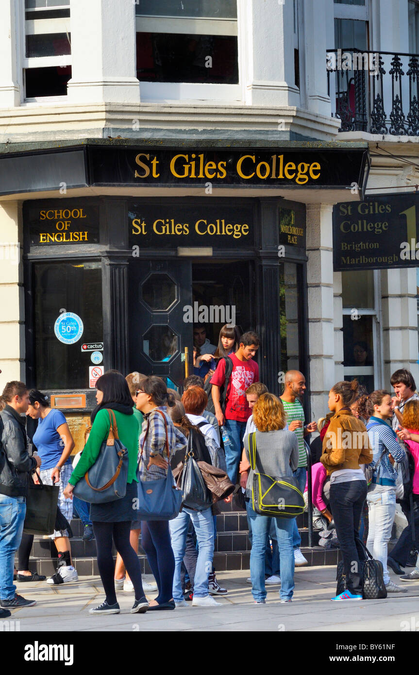 Foreign students studying English language at St Giles' College taking a break in the sunshine, Brighton, East - Stock Image