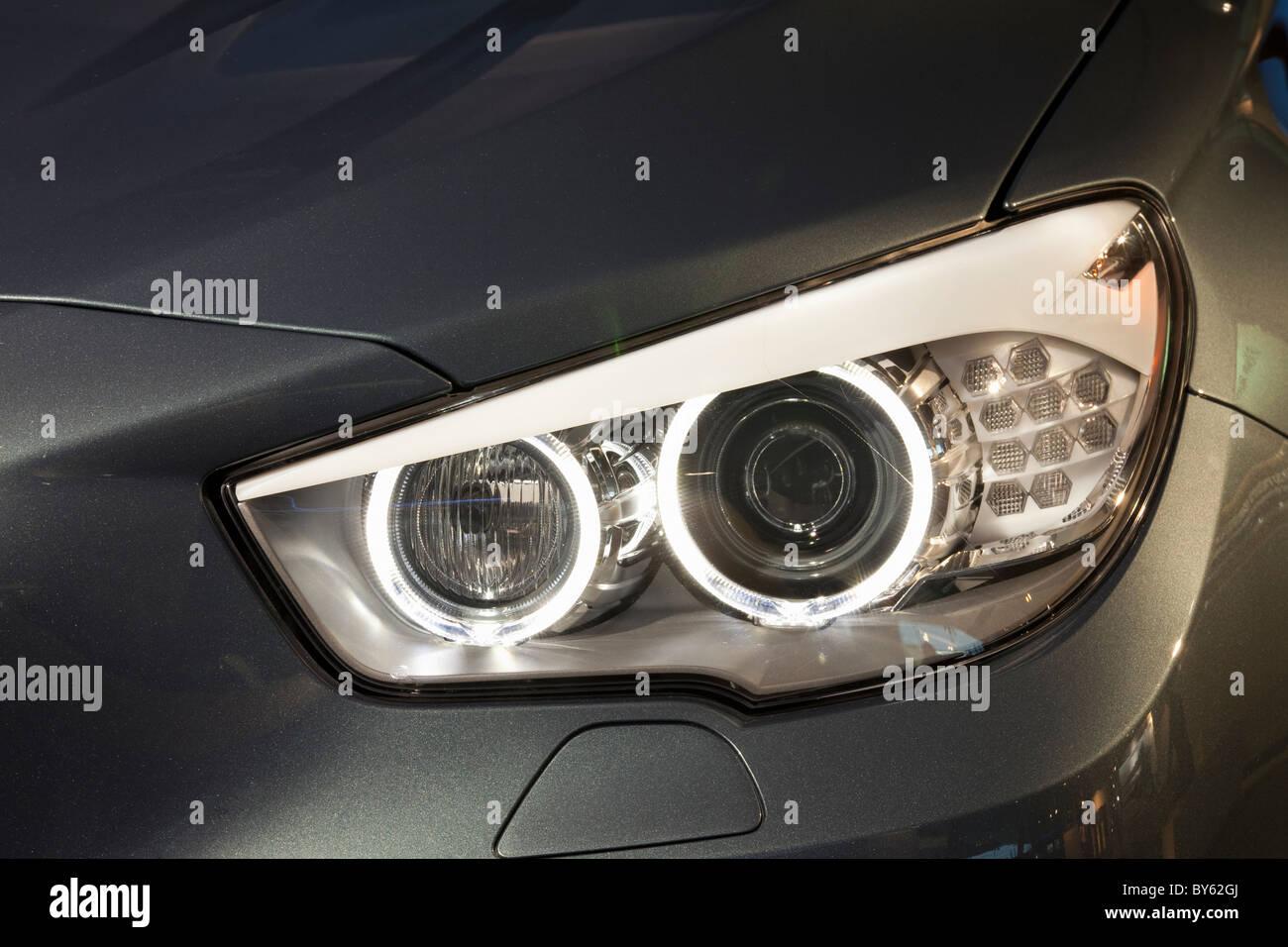 LED headlights on a BMW car - Stock Image