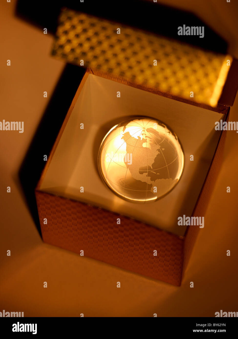 crystal globe of the earth in a gift box - Stock Image