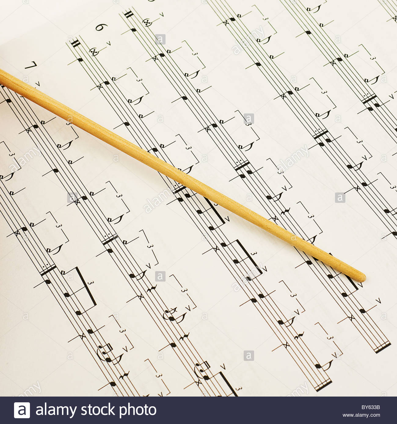 conductor baton and sheet music - Stock Image