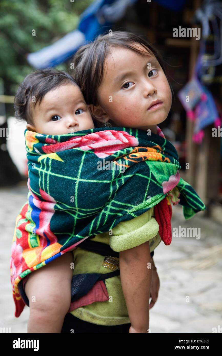 little girl and brother in Cat Cat village. Sapa, Lao Cai province, Vietnam. - Stock Image