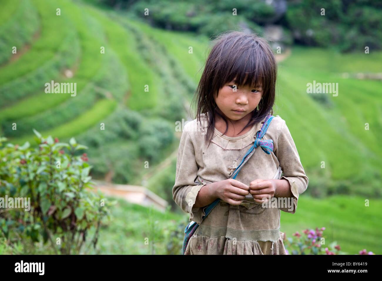 girl in Sapa-Ta Phin treeking road. Sapa, Lao Cai province, Vietnam - Stock Image