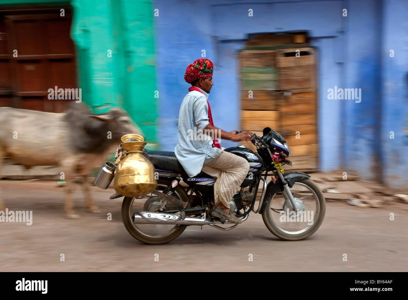 Milk delivery by motorbike, Bundi, Rajasthan, India - Stock Image