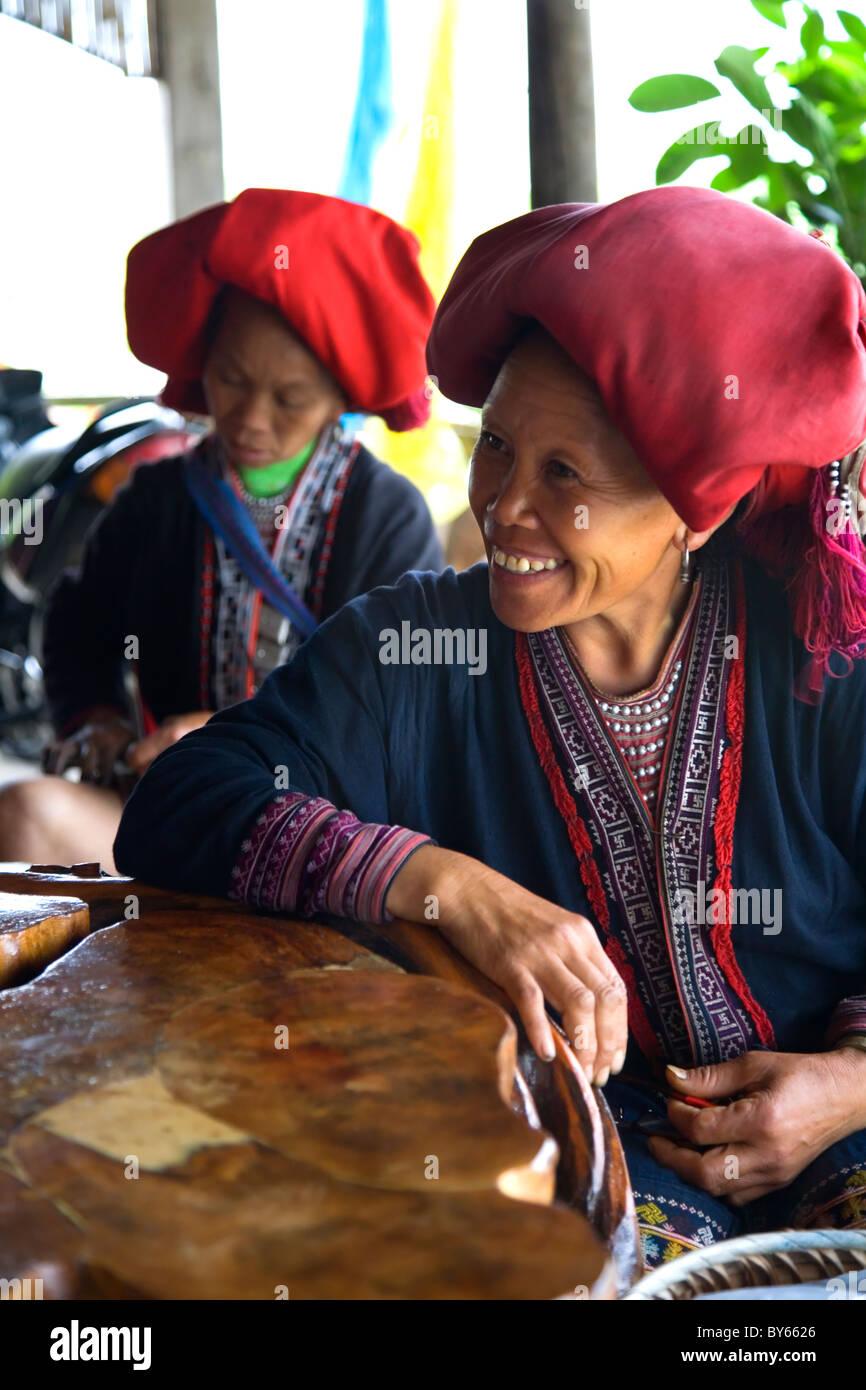 Red Dzao ethnic woman in Ta Phin village. Sapa, Lao Cai province, Vietnam. - Stock Image