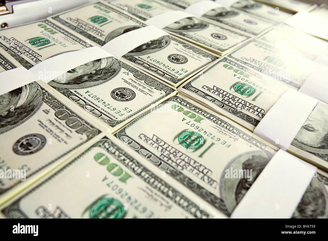 Close-up of million dollars made from lots of hundred bills - Stock Image