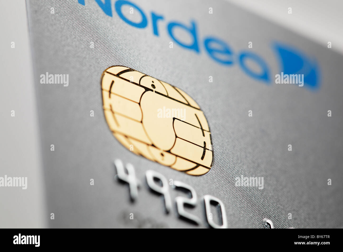 Detail of a icc chip card credit card issued by Nordea bank. - Stock Image
