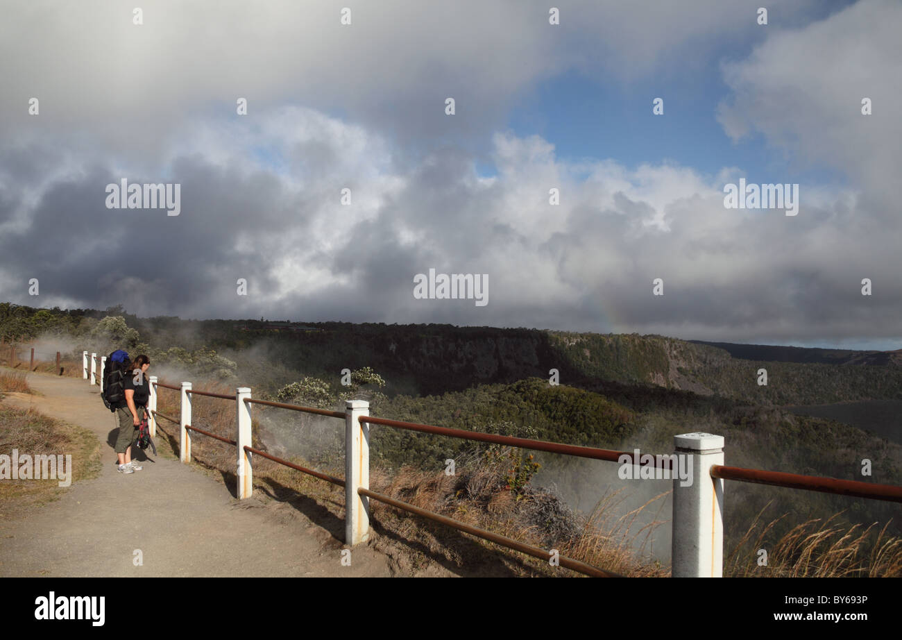 Backpacker by steaming bluff at Hawaii Volcanoes National Park on the Big Island - Stock Image