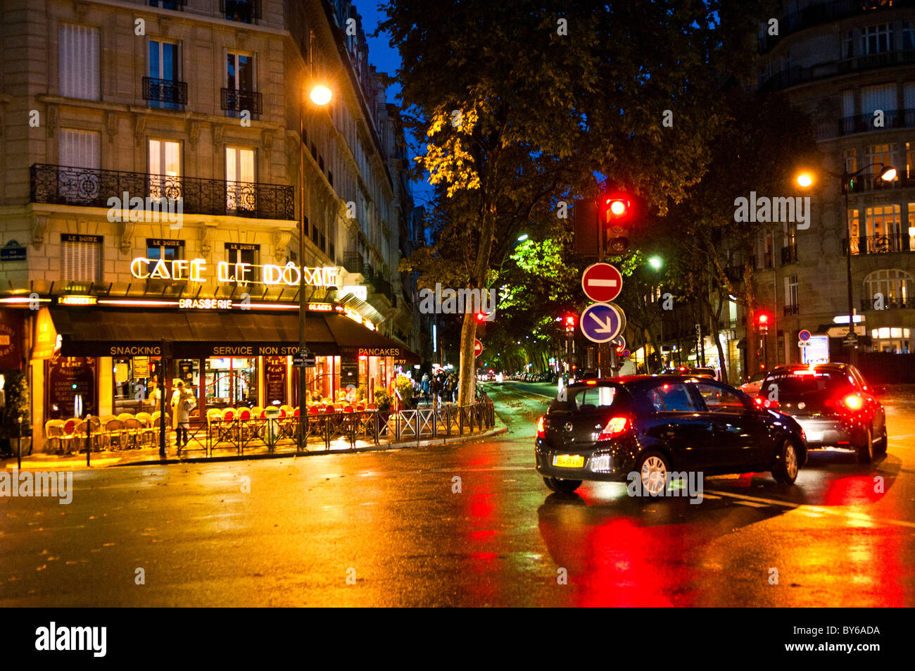 PARIS, France - Wet streets in the 7th arrondissement of Paris near the Eiffel Tower at dusk. Stock Photo