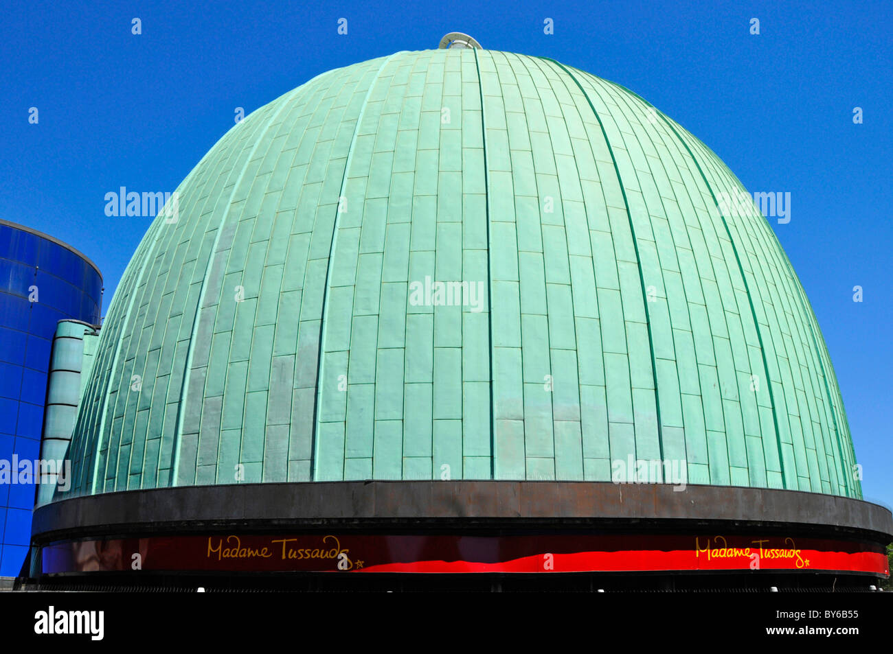 Copper cladding to roof of dome over Madame Tussauds showing typical green patina colour after weathering London - Stock Image