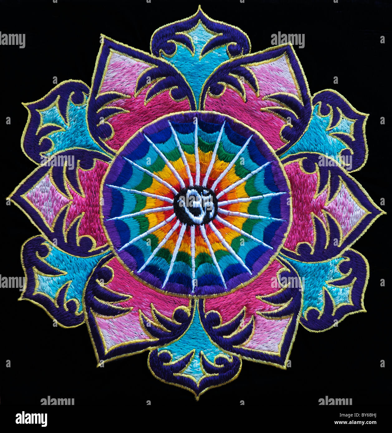 Multicoloured Hindu OM / AUM and lotus flower embroidery pattern. Indian handicraft Stock Photo