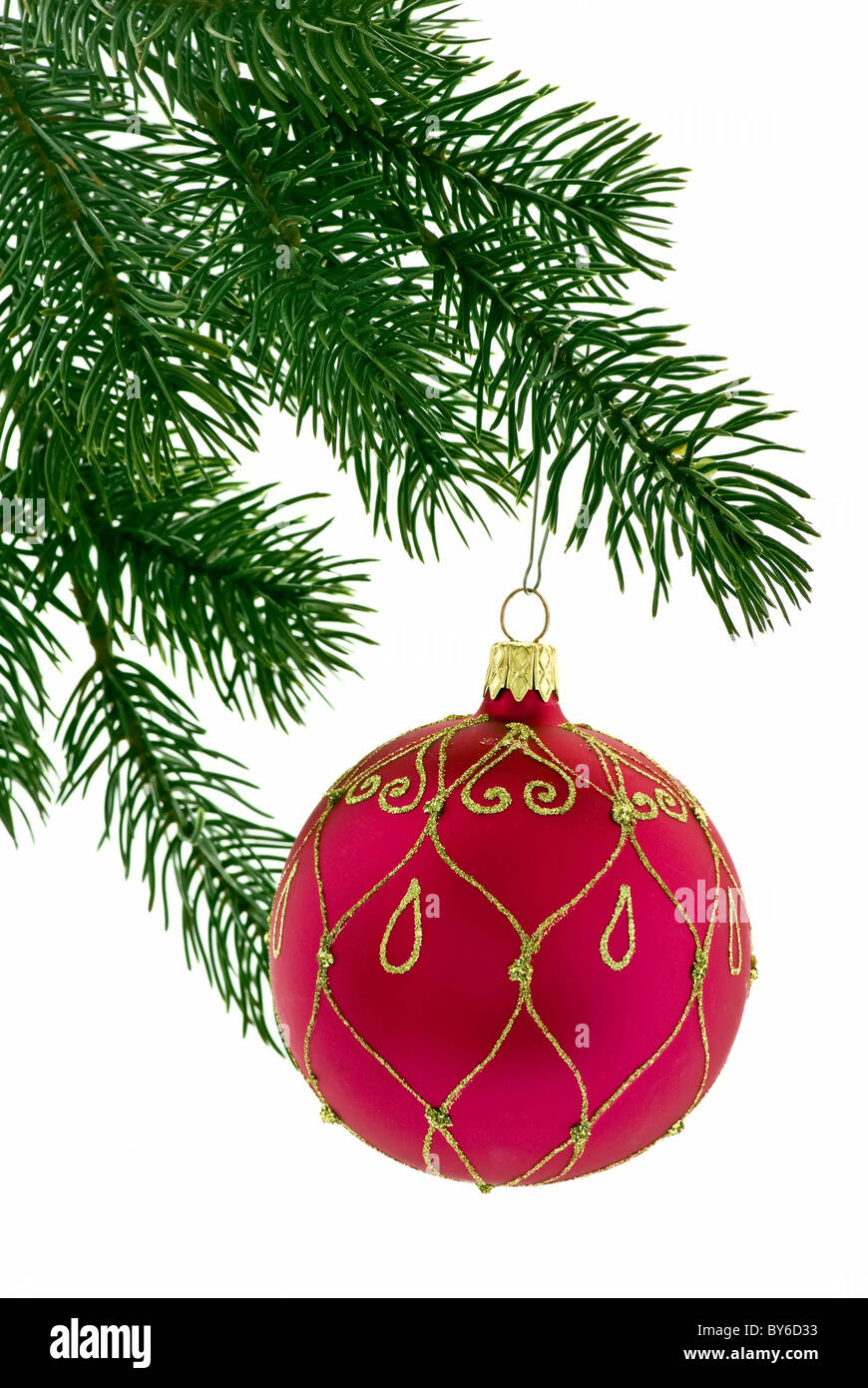 Christmas bauble as closeup on christmas tree on white background - Stock Image