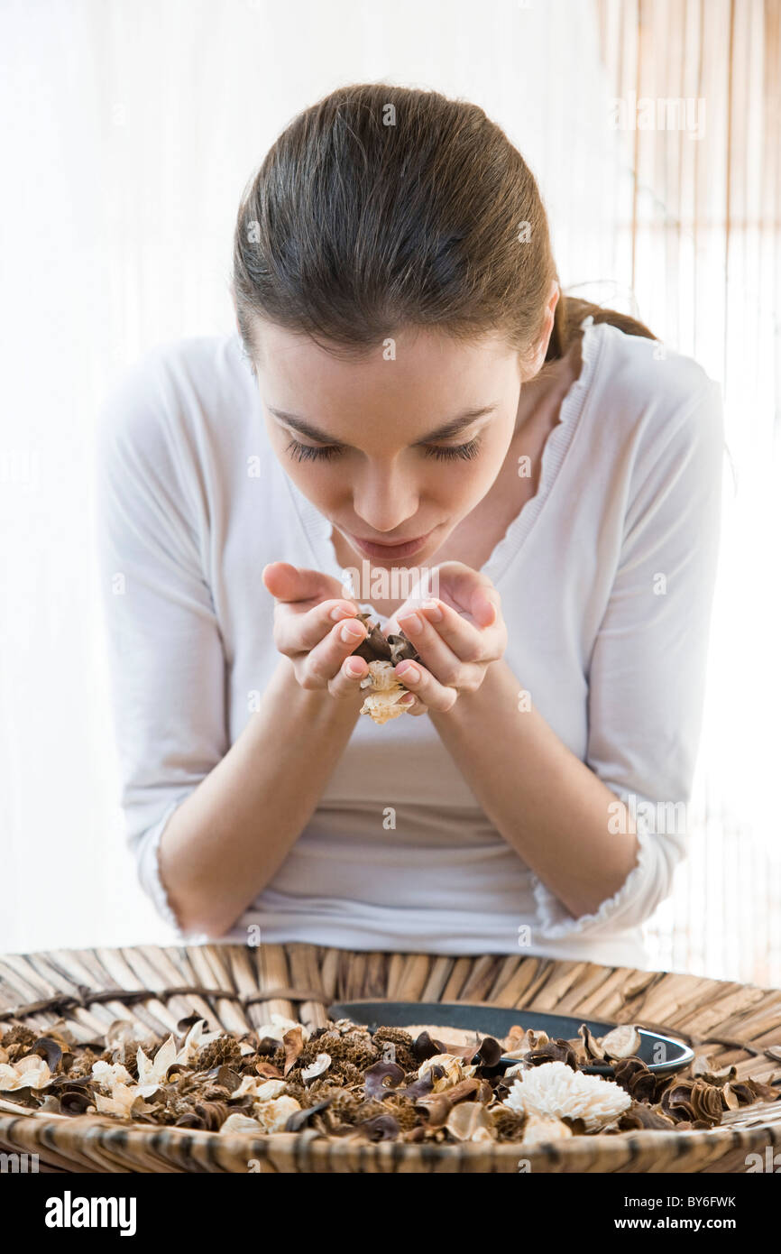 Woman using dry ingredients for aromatherapy - Stock Image