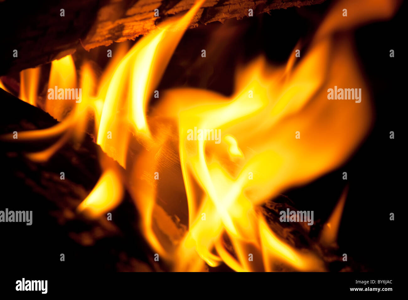 Logs burning in an outdoor campfire - Stock Image