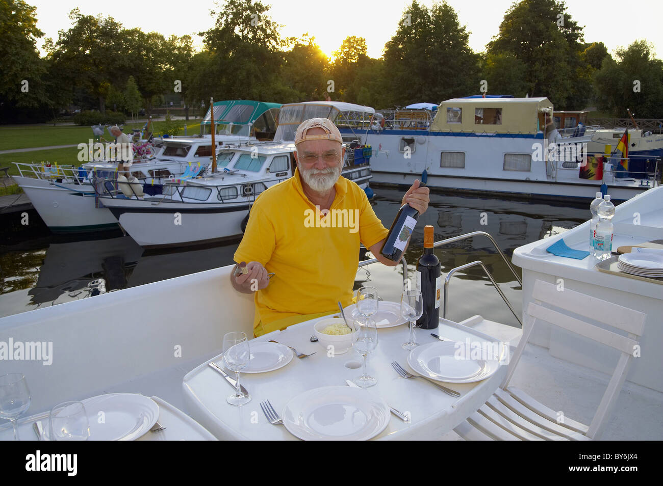 Man on a houseboat, Templin, Brandenburg, Germany - Stock Image