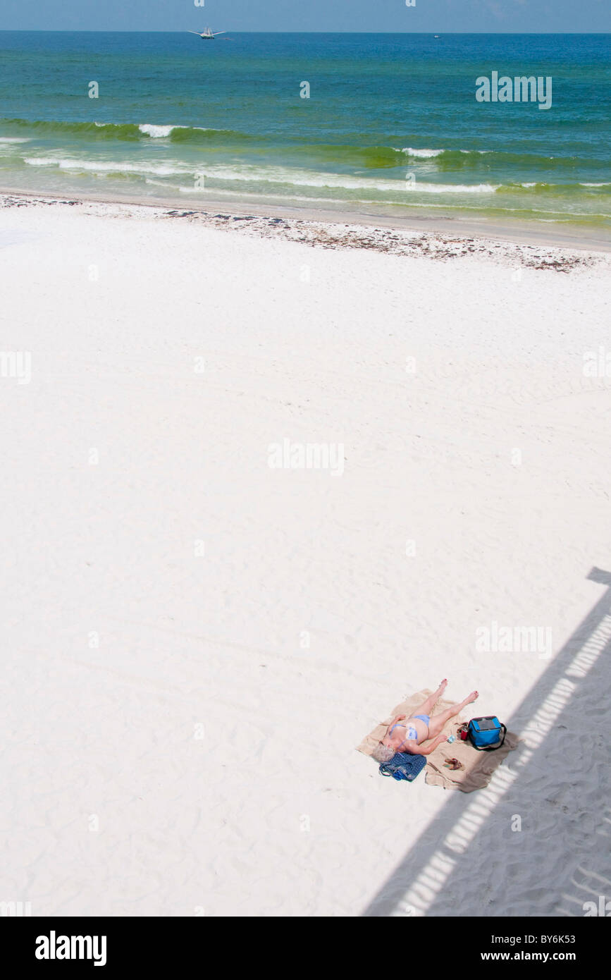A lone sunbather lays on Pensacola Beach at the height of tourist season as BP oil washes ashore Stock Photo