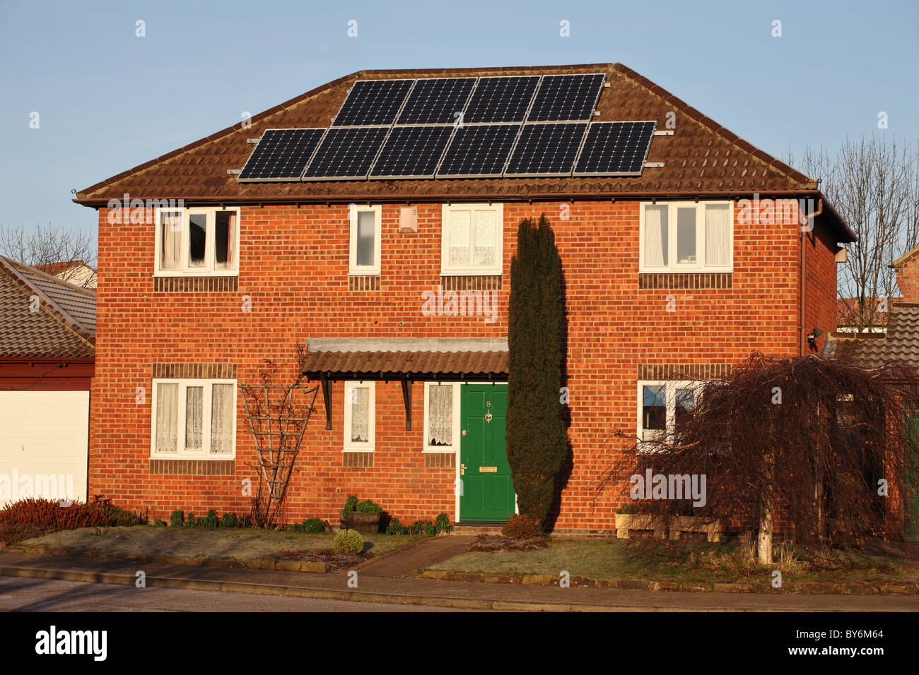 A  photo voltaic solar panel installation on a domestic house in Washington, North East England, UK. - Stock Image