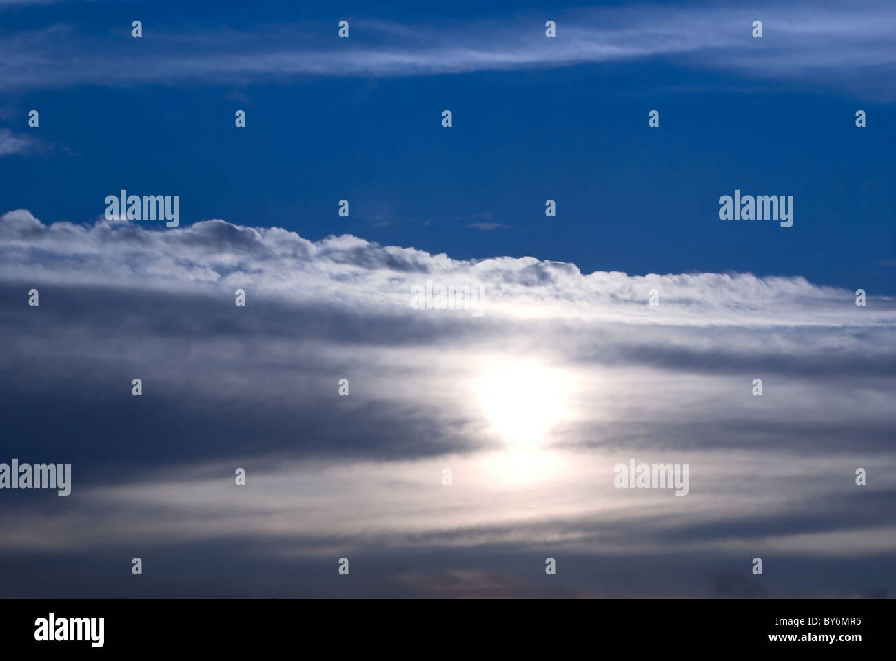 gloomily cloud over sun. cloudscape - Stock Image