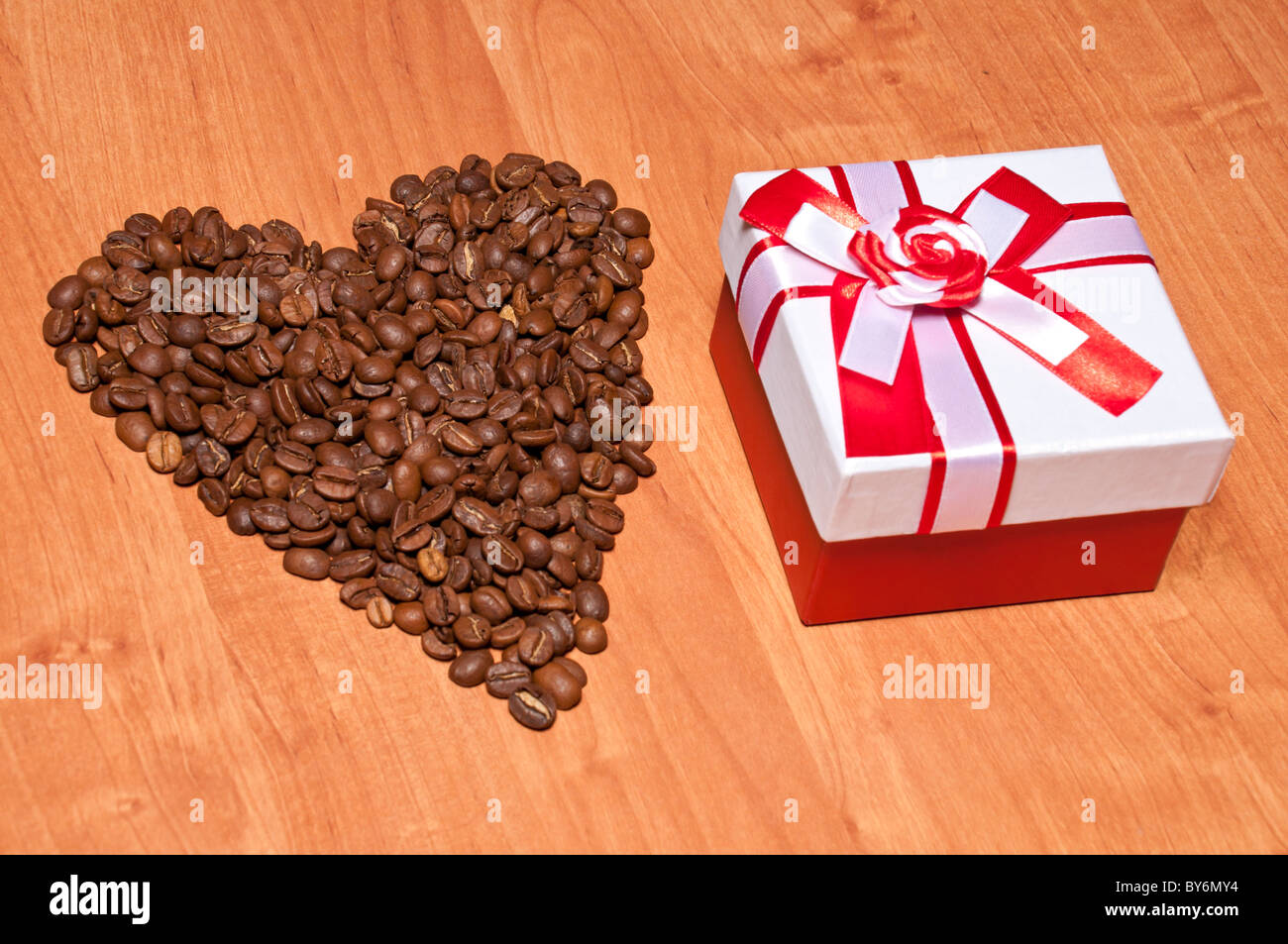 St. Valentine day's surprise: coffe heart and gift - Stock Image